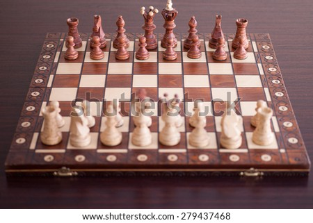 Wooden chess board with figures - stock photo