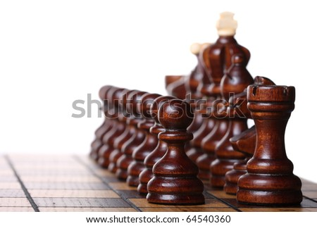 Wooden chess pieces on a chess board ready to battle. Isolated on white, shallow DOF - stock photo
