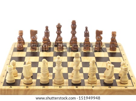 wooden chess pieces on white background