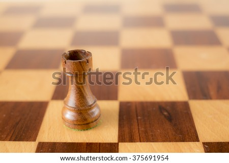 wooden chess set, black rook on board