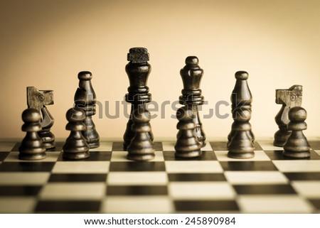 Wooden chess set vintage sepia monochromatic. - stock photo