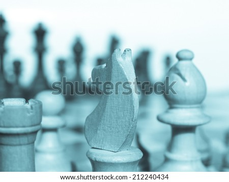 Wooden chessboard with light and dark wood checkers - cool cyanotype - stock photo