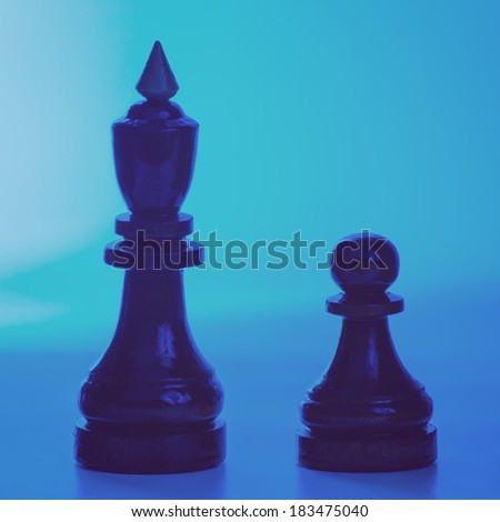 Wooden chessmen. King and pawn chess pieces. Filtered image - stock photo