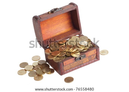 wooden chest filled with gold coins - stock photo