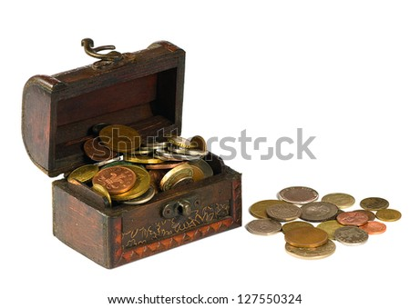 Wooden chest with coins on a white background