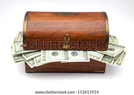 wooden chest with hundred dollars - stock photo