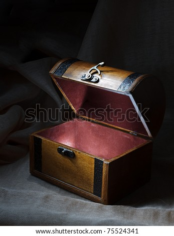 Wooden chest with light from inside. - stock photo