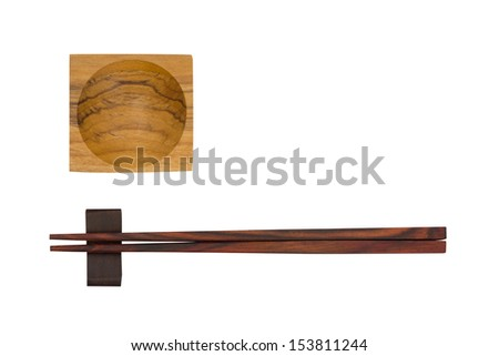Wooden chopsticks and cup of sauce isolated on white background - stock photo