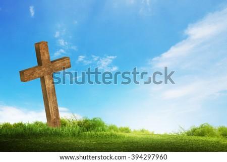 Wooden christian cross. Religious concept image - stock photo