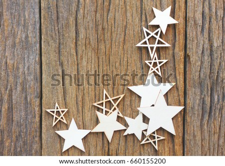 Wooden christmas background with a handmade star for decoration.