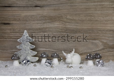 Wooden christmas background with decoration in white, silver and grey. - stock photo