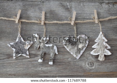 Wooden christmas decoration on wooden background - stock photo