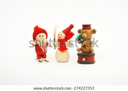 wooden Christmas dolls (santa clause, snowman and bear) on white background