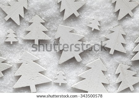 Wooden Christmas trees on snow - stock photo