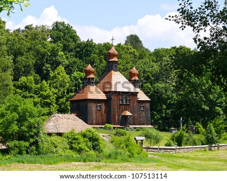 Wooden church at the Pyrohiv (Pirogovo) outdoor Museum of Folk Architecture and Life of Ukraine. It's located at the outskirts of the Kiev, the capital of Ukraine - stock photo