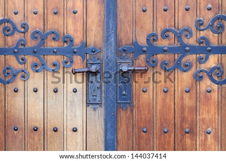Wooden church door with metal ornaments of the Franciscan church in Maribor