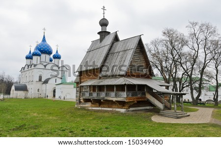 Wooden Church of St. Nicholas and Cathedral of the Nativity in Suzdal, Russia - stock photo