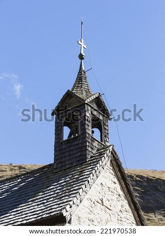 Wooden church tower, over reservoir, Grossglockner, Austria - stock photo