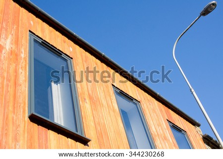 Wooden cladding on the exterior of a modern eco building in Scotland - stock photo