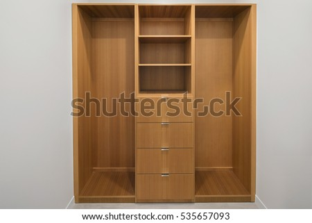 Wooden Closet with Built In Shelving