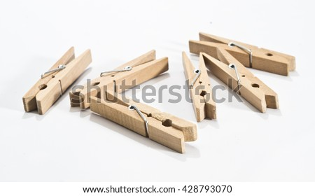 Wooden clothes clips isolated on white - stock photo