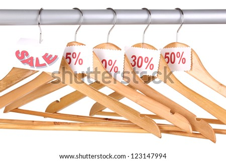 wooden clothes hangers as sale symbol isolated on white - stock photo