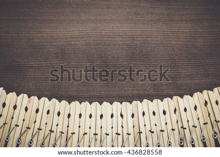 wooden clothes pegs on the brown table - stock photo