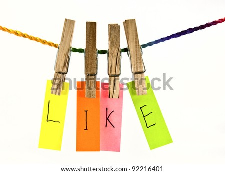 Wooden clothes pin and colorful words series on rope - stock photo