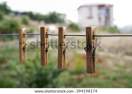Wooden Clothes Pin on Clothes Line - stock photo
