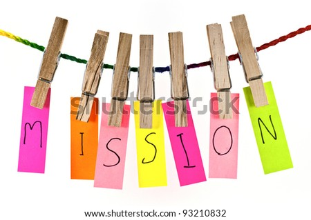 Wooden clothespin and colorful words series on rope - stock photo
