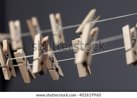 wooden clothespins on a rope - stock photo
