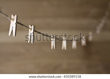 wooden clothespins on a rope