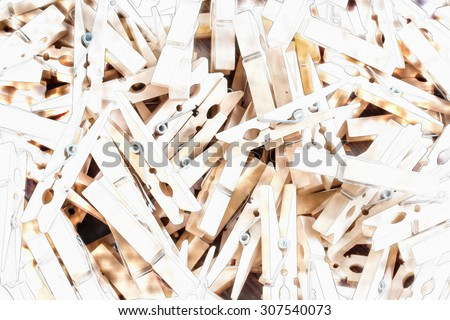 wooden clothespins piled on the floor and dark wood.with watercolor techniques