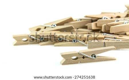 wooden clothespins piled on white background - stock photo