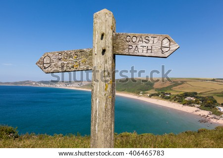 Wooden coast path sign overlooking Woolacombe Beach in North Devon, England, UK