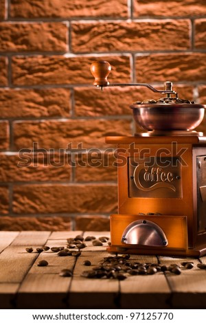 wooden coffee grinder on table