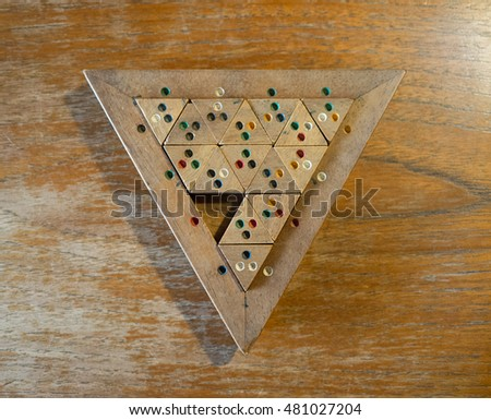 Wooden Color Match Triangle game/toy for fun on a wooden table