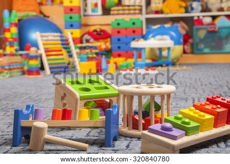 wooden color toys in room for children - stock photo