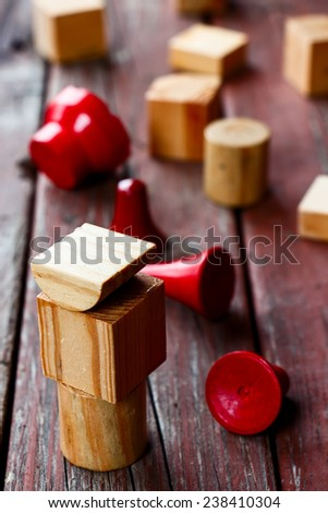 wooden colored cubes on wooden background, selective focus - stock photo