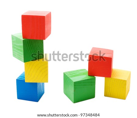 Wooden colored cubes tower toys isolated on white background - stock photo