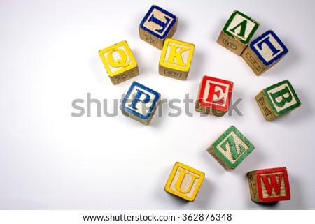 Wooden Colorful Letters on White Background.