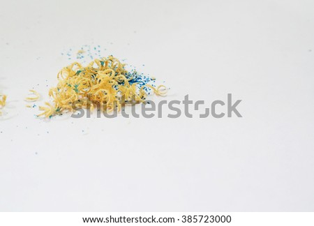 Wooden colorful pencils with sharpening shavings in white isolated background - stock photo