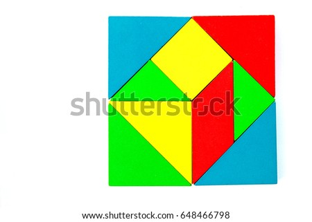 Wooden colorful toy block in multiple shape build to square design on white background