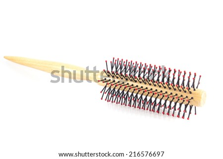 Wooden comb is on white background.