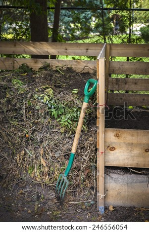 Wooden compost boxes with composted soil and yard waste for backyard garden composting - stock photo