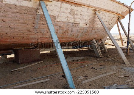 wooden construction of yacht boat in egypt - stock photo