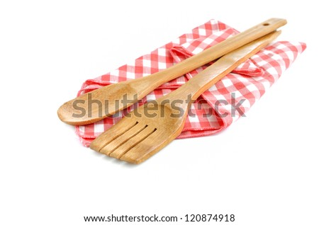 Wooden cooking utensils isolated on white - stock photo