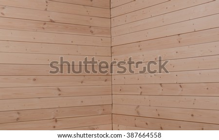 Wooden corner.Inboard joint from the wooden planks in the house