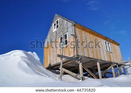 Wooden cottage in snowy winter ,the Kulusuk village, Greenland - stock photo