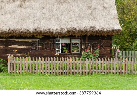 wooden cottage in village in Poland - stock photo